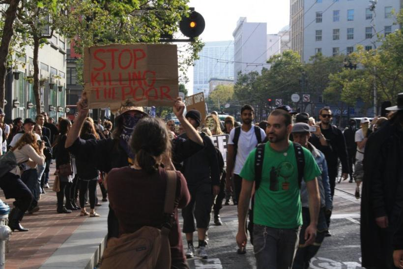 "The protesters roamed up and down Market Street for several hours, holding the sign board written with ""Stop Killing the Poor,"" ""BART Cops Murder Passengers,"" ""Free Speech."" Some people even put the posters - ""Disband th"