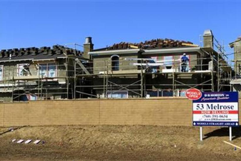 Construction workers continue work on a new subdivision of homes in San Marcos, California