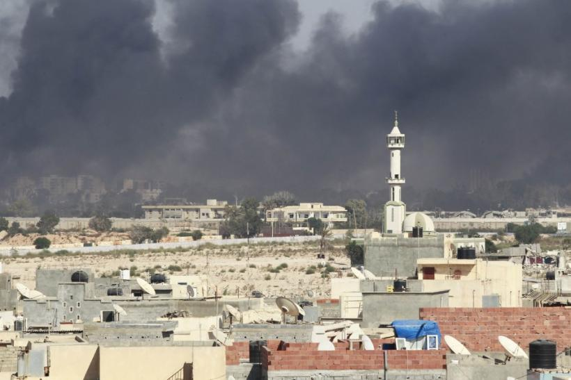 Smoke rises above downtown Tripoli following fighting at Bab Al-Aziziya compound