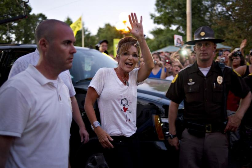 Former Alaska Governor Sarah Palin greets guests following a television appearance at the Iowa State Fair in Des Moines, Iowa