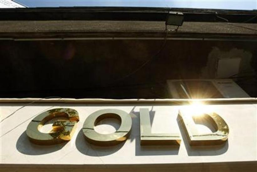 The logo of a gold jewellery shop is seen in Bucharest