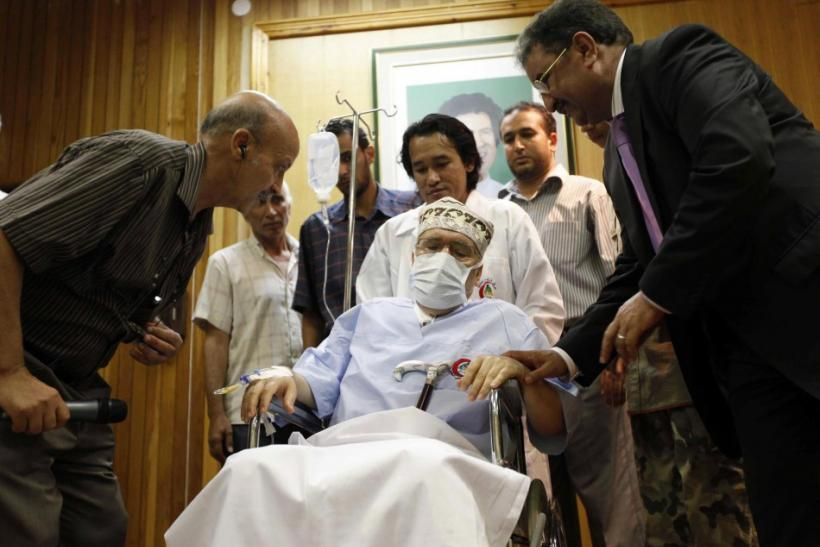 Abdel Basset al-Megrahi sits in a wheelchair in his room at a hospital in Tripoli