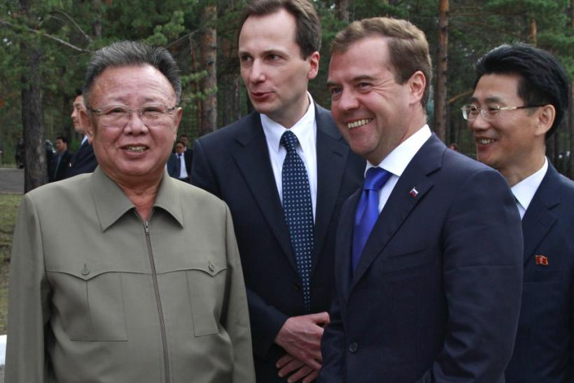 "Russia's President Medvedev and North Korean leader Kim smile during their meeting at the ""Sosnovyi Bor"" military garrison in Siberia's Buryatia region"