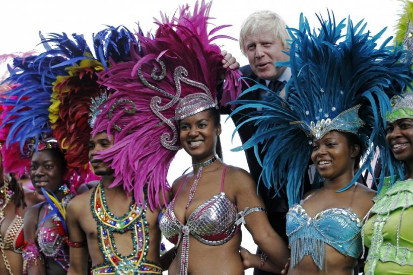 London Mayor Boris Johnson joins dancers for a photocall to promote the Notting Hill Carnival at City Hall in London