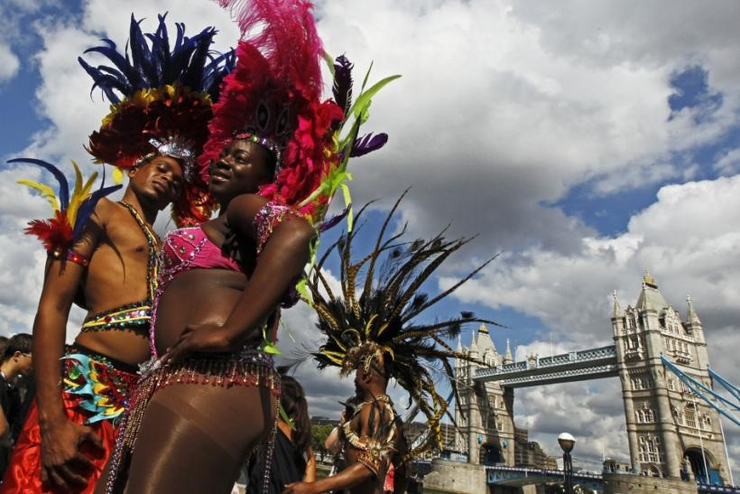 Nicole Compton and Kendell Eugene (L) pose during a photocall to promote the Notting Hill Carnival at City Hall in London