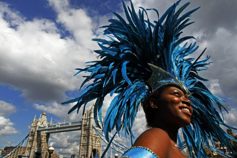 Saphra Bernard laughs during a photocall to promote the Notting Hill Carnival at City Hall in London
