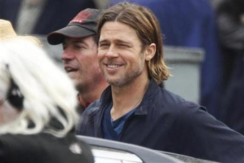 Actor Brad Pitt smiles during the filming of zombie movie 'World War Z' in Glasgow, Scotland