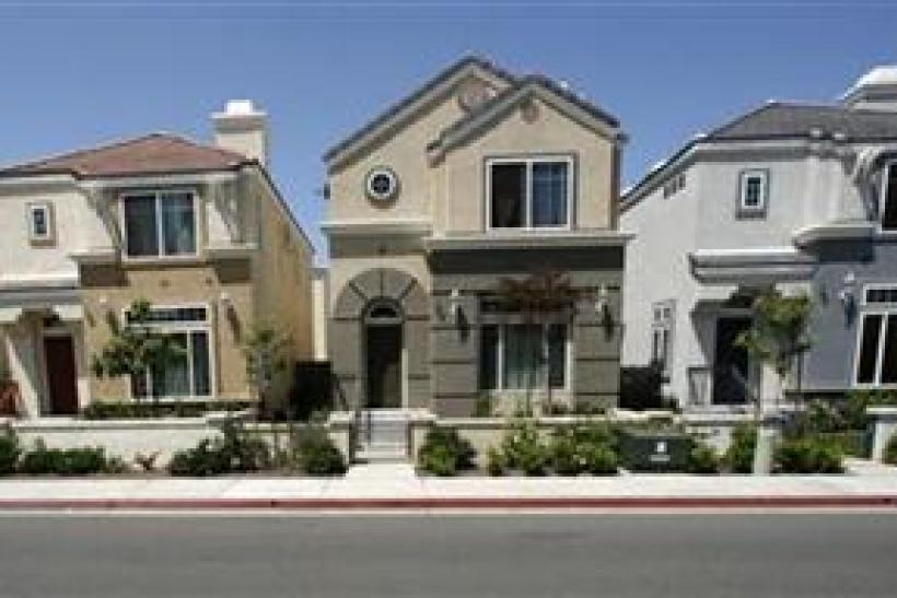 "Row homes valued at $400,000 each, which are offered for free in a ""buy one, get one free"" deal, are seen in Escondido"
