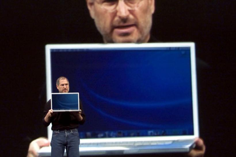 With a giant image of himself projected behind him, Apple Computer CEO Steve Jobs holds a new 17 inch Apple G4 Powerbook laptop computer during his keynote address at the Macworld Conference and Expo in San Francisco