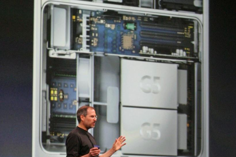 With the new Apple Power Mac G5 personal computer projected behind him, Apple CEO Steve Jobs introduces the new computer at the Apple World Wide Developers Conference in San Francisco