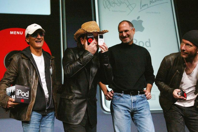 U2 lead singer Bono jokes as he stands with Apple CEO Steve Jobs and U2 guitarist The Edge during a news conference in San Jose.