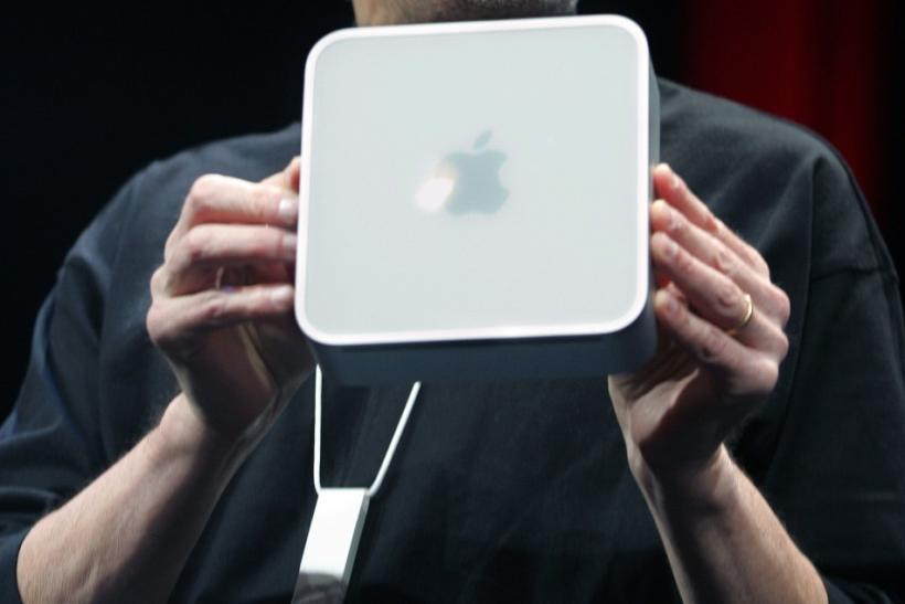Apple CEO Steve Jobs holds up Apple's new Mini Mac computer which he introduced at the Macworld Conference in San Francisco