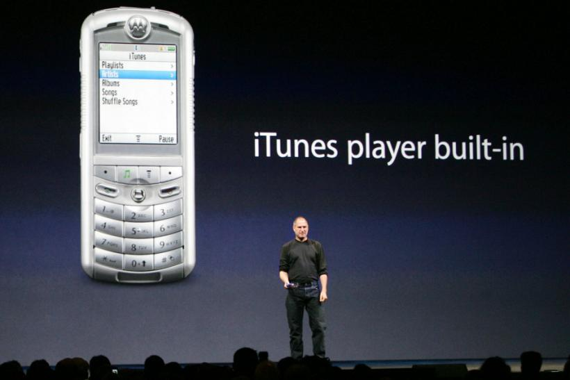 Apple CEO Steve Jobs introduces the ROKR, the world's first mobile phone with iTunes, during an event in San Francisco