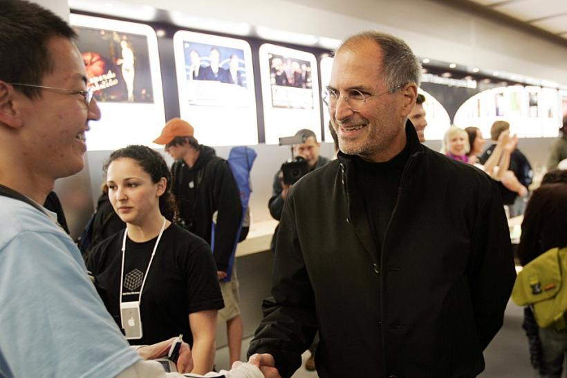 Apple Chief Executive Steve Jobs shakes hands with customers at the grand opening of the new Apple Store on 5th Avenue in New York