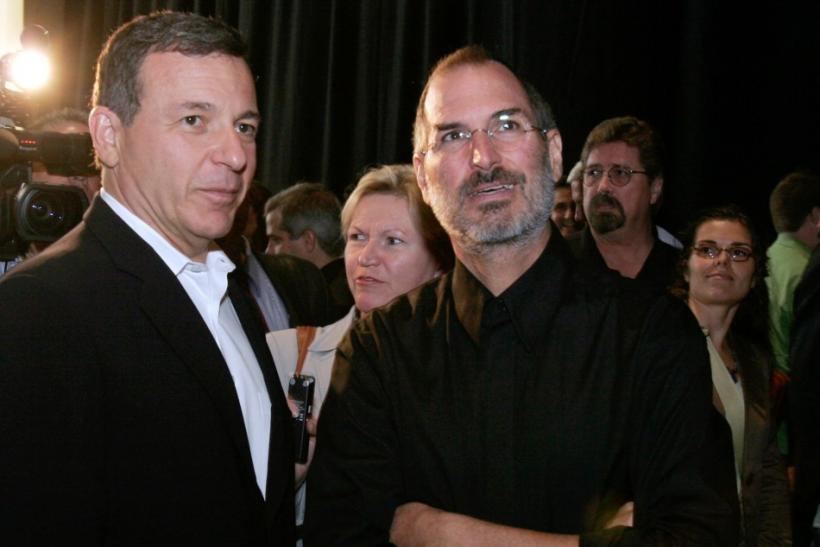 Apple Corporation CEO Steve Jobs (R) talks with Walt Disney Company CEO Bob Iger at an Apple media event at the Yerba Buena Center of the Arts theater in San Francisco, California