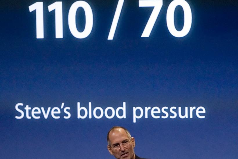 Steve Jobs, Apple Inc.'s Chief Executive Officer, makes a joke about his blood pressure after introducing the new laptop at a news conference in Cupertino, California