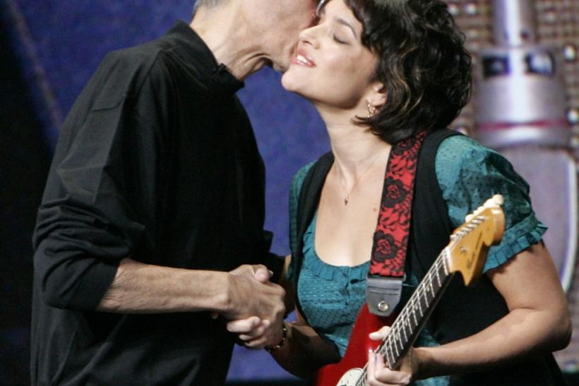 Apple Inc. Chief Executive Steve Jobs thanks musician Norah Jones for her performance at a special event in San Francisco