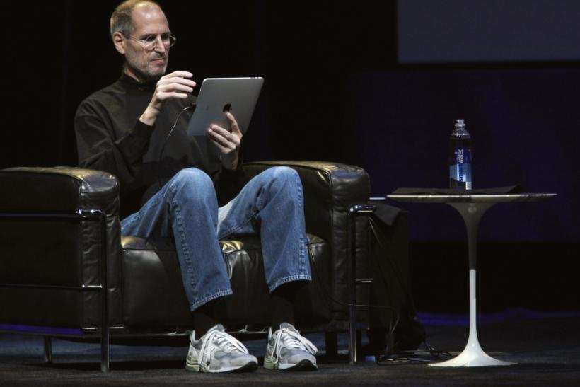 "Apple Chief Executive Officer Steve Jobs uses ""iPad"" during the launch of Apple's new tablet computing device in San Francisco, California"
