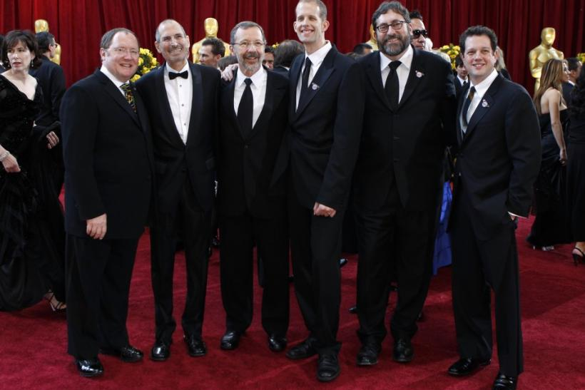 "John Lassiter (L), chief creative officer at Pixar and Walt Disney Animation Studios, poses with Apple CEO Steve Jobs (2nd L), Pete Docter (3rd R) and the rest of the team from the best picture nominated animated film ""Up"" at the 82nd Academy Aw"