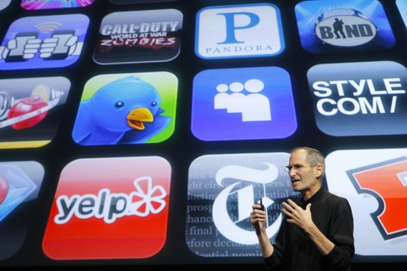 Apple Inc. CEO Steve Jobs speaks in front of the display showing buttons of various apps during the iPhone OS4 special event at Apple headquarters in Cupertino, California