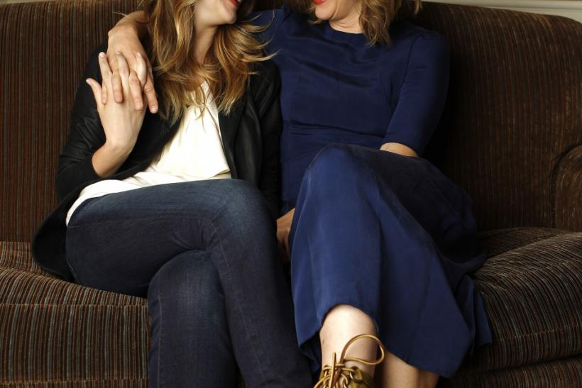 "Director and cast member Vera Farmiga (R) and her sister and cast member Taissa Farmiga pose for a portrait while promoting their upcoming movie ""Higher Ground"" in Los Angeles"