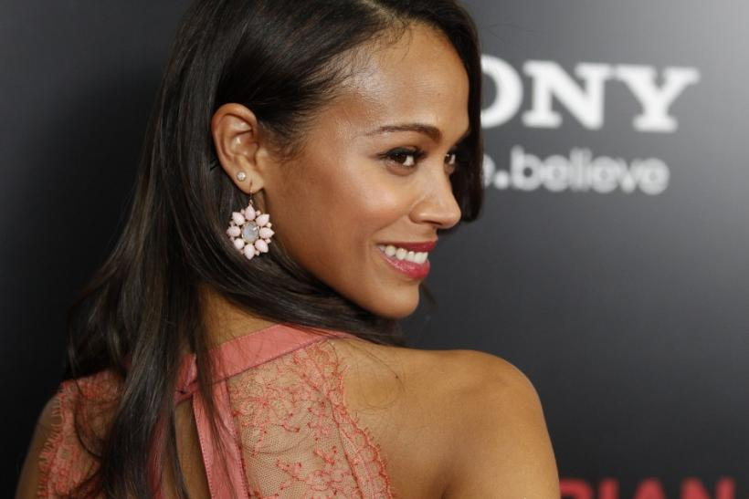 "Actress Zoe Saldana arrives at a special screening of the her new film ""Colombiana"" in Los Angeles, California"