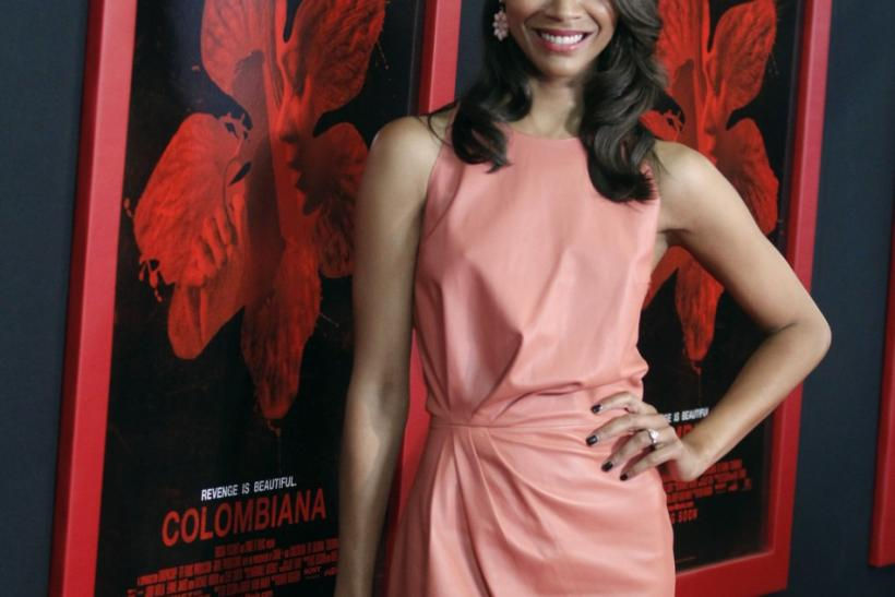 "Actress Zoe Saldana arrives at a special screening of her new film ""Colombiana"" in Los Angeles, California"