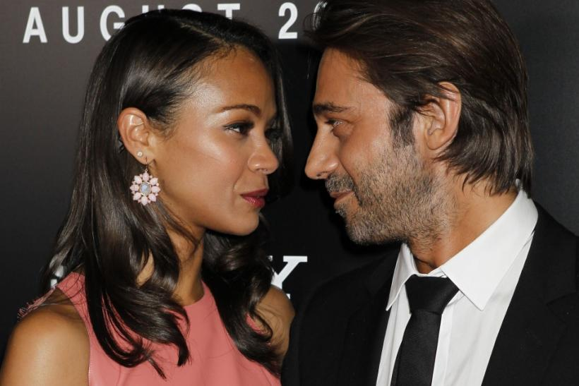"Actress Zoe Saldana and Spanish actor Jordi Molla arrive at a special screening of their new film ""Colombiana"" in Los Angeles, California"