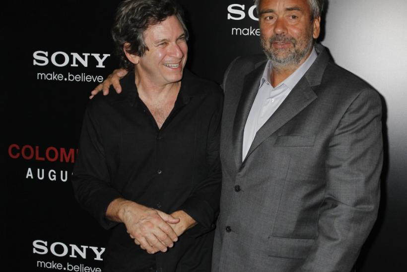 "Writer Robert Kamen (L) and writer and producer Luc Besson arrive at a special screening of their new film ""Colombiana"" in Los Angeles, California"