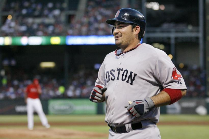 Boston Red Sox Adrian Gonzalez jogs towards the dug out after hitting a two-run home run against Texas Rangers Alexi Ogando in thier MLB game in Arlington