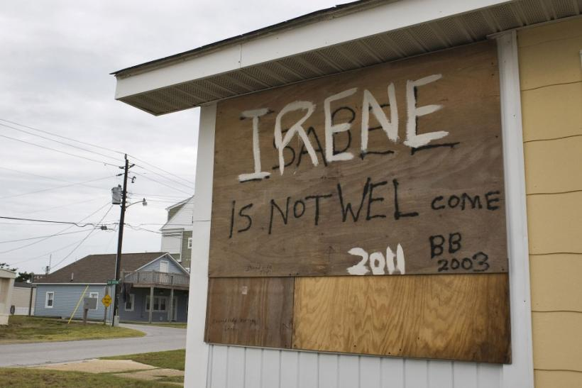 A plywood shutter, covering a window of a beachside house, shares a message from a community preparing for the arrival of Hurricane Irene in Atlantic Beach, North Carolina