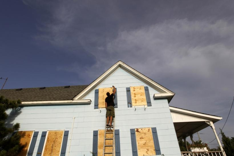 Lee Rogers boards up the windows of his friend's house at Cape Hatteras National Seashore in Salvo, North Carolina