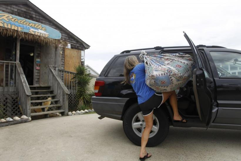 Debbie Bell loads sacks from her surf shop store into her car at Cape Hatteras National Seashore in Rodanthe, North Carolina