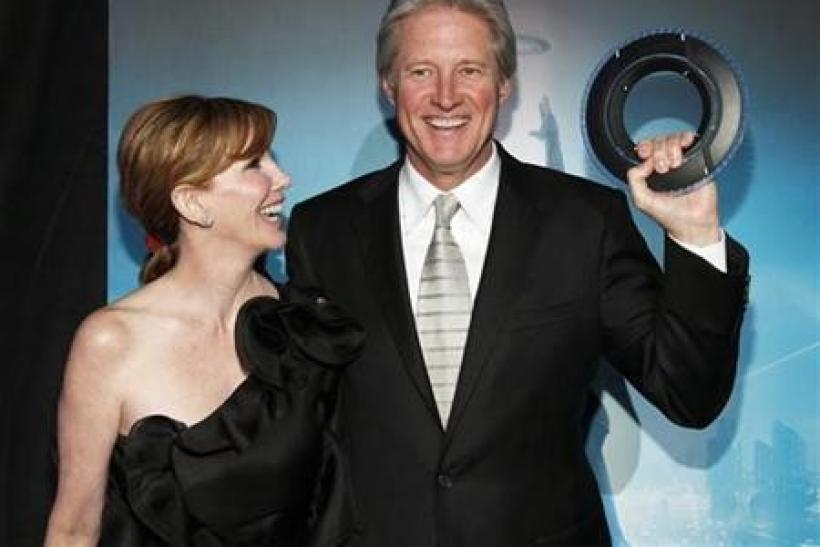 "Cast member Bruce Boxleitner holds an Identity Disc as he poses with his wife Melissa Gilbert at the world premiere of the film ""TRON: Legacy"" in Hollywood, California"