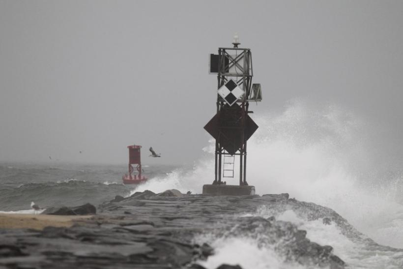 Waves crash on a breakwater during the early effects of Hurricane Irene in Ocean City, Maryland