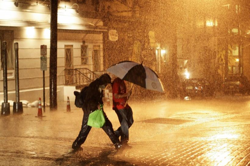 Pedestrians walk through the rain at Hoboken in New Jerseyrsy