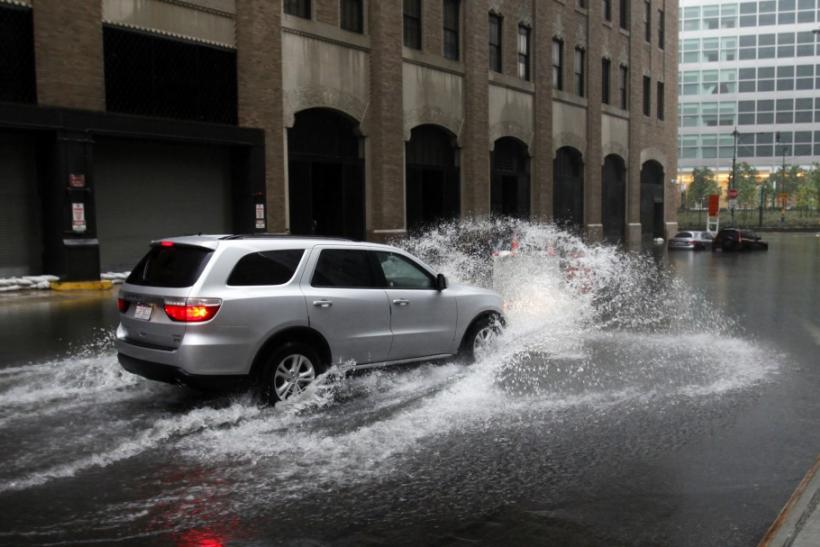 Car drives into a flooded area in lower Manhattan as Hurricane Irene closed in on New York City