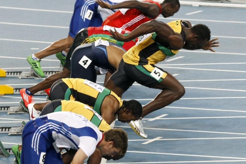 Usain Bolt of Jamaica makes a false start during the men's 100 metres final at the IAAF World Championships in Daegu