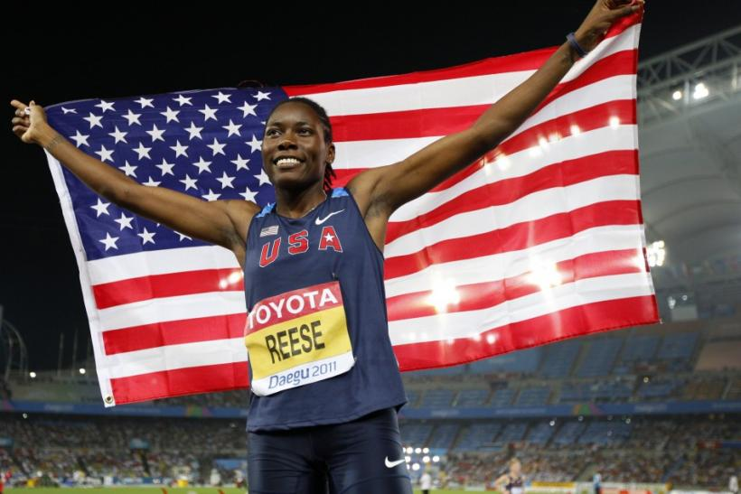 Reese of the U.S. holds her national flag as she wins the women's long jump final at the IAAF World Championships in Daegu