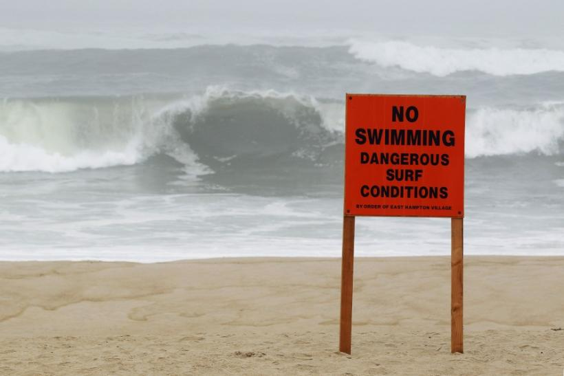 A warning sign is seen on a public beach as Hurricane Irene approaches Long Island in East Hampton Village