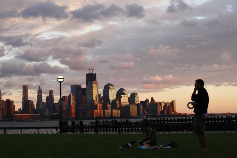 With the skyline of New York in the bakground, people enjoy the sunset along Hudson river after the pass of Hurricane Irene at Hoboken in New Jersey