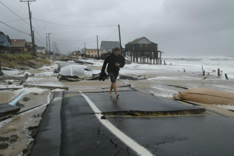 A resident walks over the buckled highway 12 after Hurricane Isabel plowed into Kitty Hawk on the Outer Banks of North Carolina