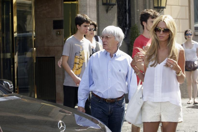 Formula One supremo Bernie Ecclestone and his daughter Petra leave a hotel in downtown Rome