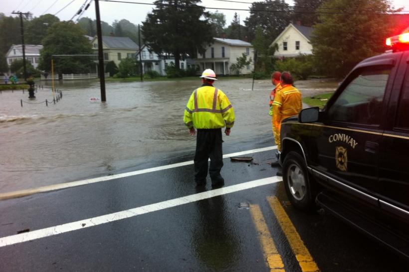 Conway, Massachusetts city personnel look at flooding from the South River