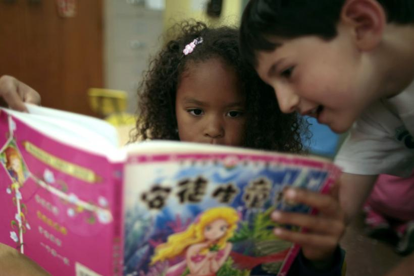 Aniya Cope and Ryan Goss, 5, read a Chinese book at Broadway Elementary School in Venice, Los Angeles