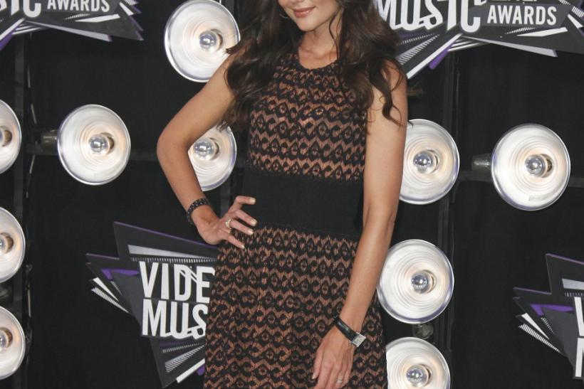 Actress Katie Holmes poses as she arrives at the 2011 MTV Video Music Awards in Los Angeles