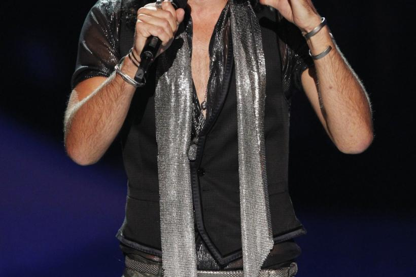Actor Russell Brand introduces a tribute for late singer Amy Winehouse at the 2011 MTV Video Music Awards in Los Angeles