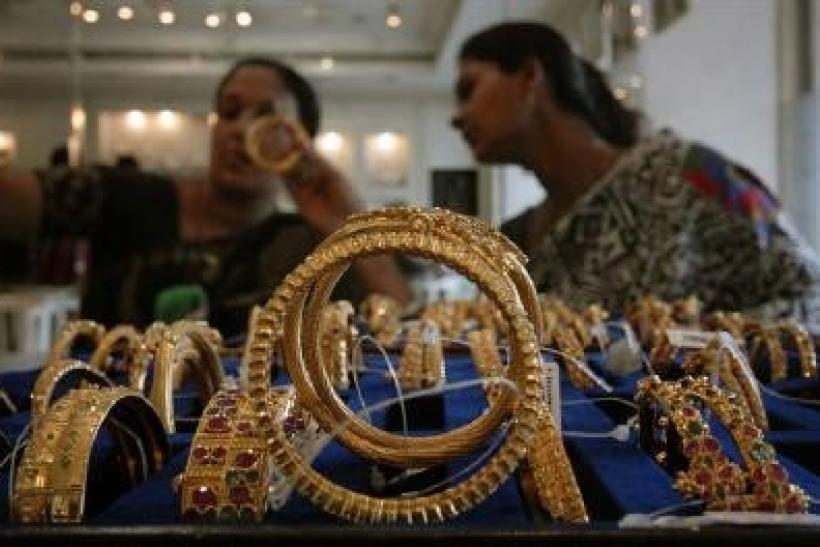 India gold edges up after previous day's 3 pct fall
