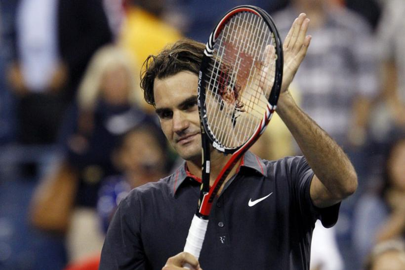 Federer of Switzerland celebrates defeating Giraldo of Colombia during the U.S. Open tennis tournament in New York
