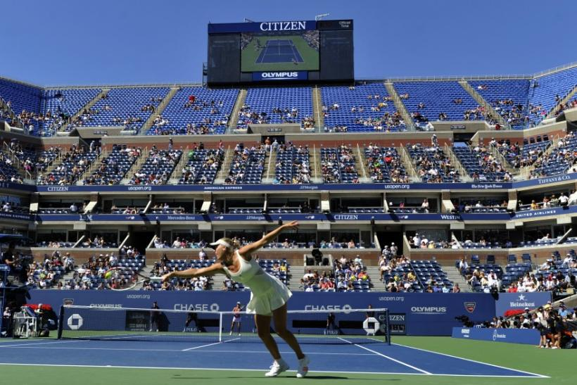 Caroline Wozniacki of Denmark hits a return to Nuria Llagostera Vives of Spain during their match at the U.S. Open tennis tournament in New York